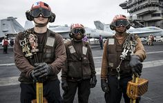 "GULF OF OMAN (July 15, 2013) - Plane captains assigned to the ""Wolf Pack"" of Helicopter Maritime Strike Squadron (HSM) 75 stand by to chain down an MH-60R Seahawk helicopter on the flight deck of the aircraft carrier USS Nimitz (CVN 68). Nimitz Strike Group is deployed to the U.S. 5th Fleet area of responsibility conducting maritime security operations, theater security cooperation efforts and support missions for Operation Enduring Freedom. Us Navy Aircraft, Navy Aircraft Carrier, Military Aircraft, Military Gear, Military Life, Navy Carriers, Uss Nimitz, Armor Clothing, Flight Deck"