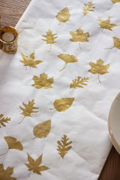 Last Minute Ideas for your Thanksgiving Feast | Papa Ben's Kitchen - This unique DIY project uses just a roll of butcher paper, some leaf stencils and gold craft paint. It's practical and elegant and fun for your kids too.