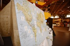 travel themed wedding seating chart, each table is named after a city the couple has traveled to