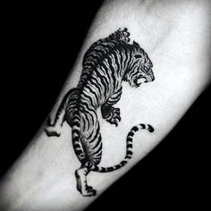 Tiger Tattoos Designs On Man's Wrist