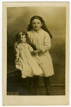 Vintage photos of little girl with her doll, circa 1910.