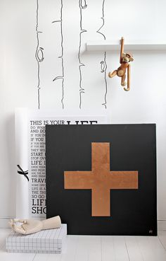 DIY + painting  First, I painted the canvas in matte black, before I measured and drew the cross with a pencil so I knew where to put the masking tape. Then I painted the cross the with shiny copper to create a contrast against the matte. Stylizimo Blog