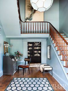 Honeymoon mansion foyer is painted in a serene blue-gray