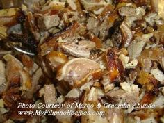 "Dinakdakan is a grilled pig's head parts (e.g. ear, nape, face) and offal (e.g. tongue, liver, intestines) blended with pig's brain. It is a very popular dish in Ilocos region. For the Ilocanos, this Dinakdakan dish is an epitome when it comes to ""finger food"" (pulutan) to accompany beer, liquor, wine, or cocktail drinks. It is a very authentic dish and one hundred percent (100%) Filipino."