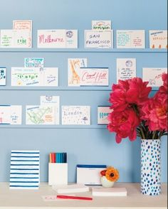 """Instead of a guest book, party-goers illustrated cards at a """"postcard station,"""" noting where they'd traveled from. Follow the link to view this crafty wedding from start to finish."""