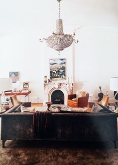 brown velvet sofa and chandelier