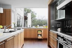 eucalyptus kitchen - contemporary kitchen with eucalyptus cabinets mixed with stainless steel - alterstudio via atticmag Big Kitchen, Stylish Kitchen, Kitchen Dining, Kitchen Ideas, Mahogany Flooring, Wooden Kitchen Cabinets, White Countertops, Cabinet Design, Beautiful Kitchens