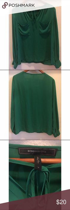 BCBG Max Azria Joss Blouse In Malachite size M BCBG Max Azria Joss Blouse  In Malachite Kelley green  Long sleeves  Tie detail at neck  Hits at hips  Size medium  100% polyester  Pre owned excellent condition  Pet and smoke free home BCBGMaxAzria Tops Blouses