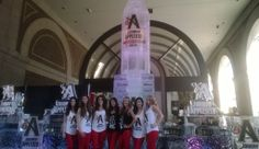 Johnny Appleseed models posing in front of the Johnny Appleseed ice luge.   #iceluges #worldrecordice #johnnyappleseed