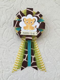 A personal favorite from my Etsy shop https://www.etsy.com/listing/260799164/mommy-to-be-ribbon-corsage-for-baby
