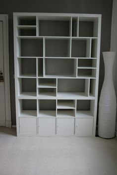 IKEA Hackers: 2x2 + 2x4 + 4x4 = My re-structured Expedit. Possibility for changing up the bookshelves in the library.