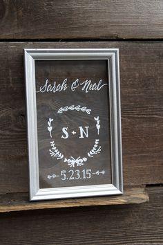 Silver framed custom painted glass wedding keepsake with monogram detail and wedding date.