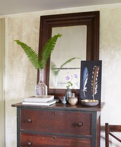 The master bedroom's dresser was a junk-shop bargain; the ogee mirror is an auction find.