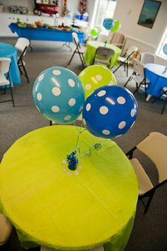navy blue and lime green whale themed first birthday party table decoration