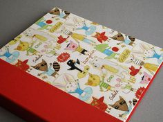 "IONA BINDING - Handmade photo album measures 13,18"" x 13,58"". Covered with Japanese fabric and red fabric."