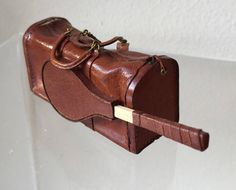 This is a Brown leather tennis bag created by Jose Gomez that is a must have for your miniature collection. The bag does not open nor does the tennis racket come out. Measures: 3 L (tip of tennis racket) x 1 W x 1 H Comes from a miniature estate and a smoke free environment. Shipping includes insurance #miniestatesbykaren
