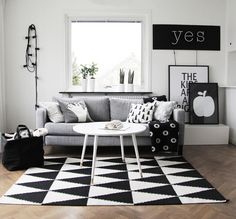 Chic monochrome living room. We love the black and white accessories and graphic prints.