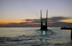 shrimp boat heading out the channel