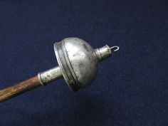 Turkmenistan – Mary, Ersary tribal silver top drop spindle. Circa 1920-1930s Size: 14″ long including top. 1/1/2″ diameter silver top. Turkmenistan – Mary, silver top wooden rot hand carved drop spindle. Silver tops will last long, rots always break and they have to change them on the way. Some of them has sayings on them against evil eye and harmful spirits.