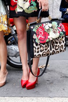 red shoes and a floral print and animal print purse. work it.