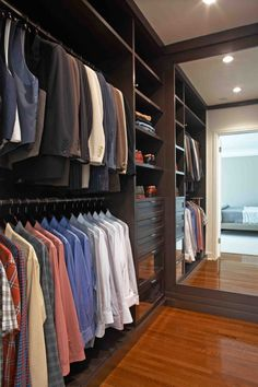 His closet. I love the full length built-in mirror. Maybe a little cushioned bench on the other wall for a place to sit when putting on shoes? Just needs a little area to place watches, wallet, change and a charging station for phone, etc.