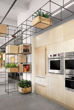 Appliance Love by DesignAgency. Interesting retail display and/or home kitchen cabinetry thought..