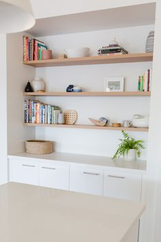 Fresh Dulux Whisper White walls, floating timber shelves.  I love designing built in joinery, it can add so much to the interior of any home.