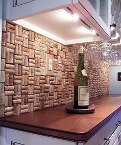 Wine cork backsplash. Not only protect the walls from staining, but also add a decorative touch to your kitchen design.
