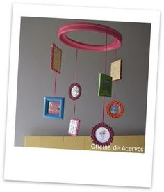DIY crib mobile. put pictures of your favorite images and change out from time to time to make new. this is one mobile that can be always used in the child's room