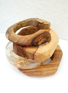 Kiaat wood from Mozambique, skinkwood from South Africa and resin with gold leaf. Africa Rich bangles by Theresa Burger .