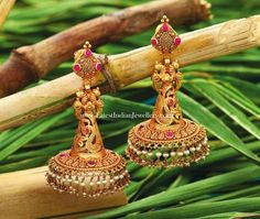 Distinct and attractive designer gold jhumka earrings in unique design. The antique gold earrings with cone shaped jhumka in parrot design studded with pota rubies agpai Gold Jhumka Earrings, Antique Earrings, Antique Jewelry, Antique Gold, Gold Necklace, Indian Jewellery Design, Indian Jewelry, Jewelry Design, Jhumka Designs