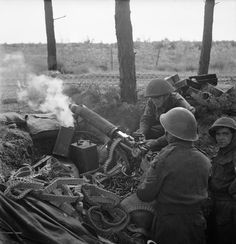 Vickers machine guns of 2nd Middlesex Regiment, 3rd Division, fire in support of the attack on Overloon, 14 October 1944.