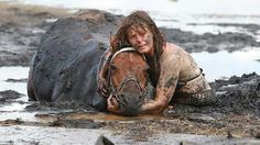 This horse was rescued. His mama did not leave his side for the entire 3 hour ordeal, keeping his head from sinking in the mud and comforting him while rescuers worked. Australia.