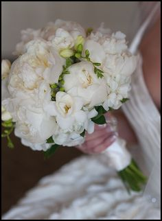 Wild Bunch Studio  photo by Amy Dykens  White on white. We can replace peony (out of season for your wedding) with white garden roses.