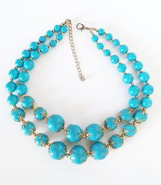 Modern Vintage 1980s Turquoise Graduated Beaded Jewelry, Necklace with Silver Filigree Bead Caps, Offered by MimisJewelryBoutique Color: Turquoise and Silver Tone Approximate Measurements: 1st strand 13 1/2 with 3 adjustable length; 2nd strand 16 Condition: Very Vintage Good -