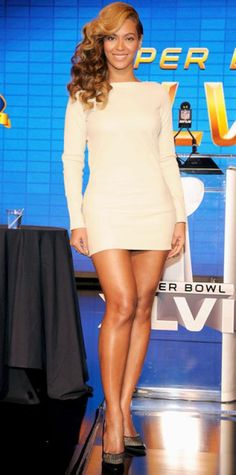 Look of the Day › February 1, 2013 WHAT SHE WORE The singer flaunted her gams in a leather mini and sheer Jimmy Choo pumps at a press conference for the Super Bowl halftime show. WHY WE LOVE IT Ravens and 49ers who? With legs like hers, our eyes will be on Beyonce!
