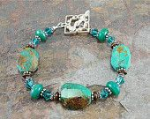 MOVING SALE Aqua bracelet, lampwork beads bracelet, Bali silver and crystal beads bracelet, Cleo. $74.25, via Etsy.
