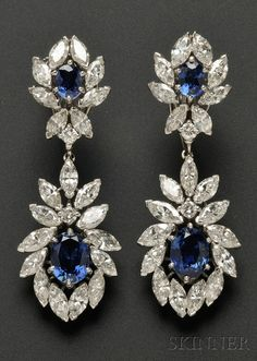 Platinum, Sapphire, and Diamond Day/Night Earpendants, set with cushion-shape sapphires framed by marquise and full-cut diamonds, approx. total wt. 7.38 cts., lg. 2 in; purchased in the 1970s from #Cartier