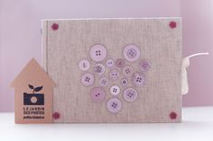 Handmade photoalbum decorated with buttons