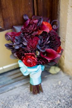 Burgandy, purple, reds, turquoise. I love the unfurling fronds!