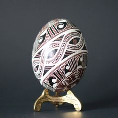 Trypillian egg tribal native drawings symbols of infinite life aboriginal artifacts inspired design with watchful eye intertwined snakes