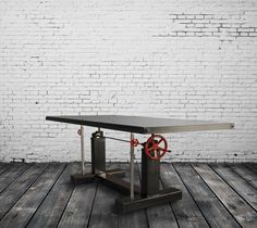 Base price includes a 96 x 40 steel top Standard Size: 96 x 40 and 120 x 48 (custom sizes available) Casters are optional Red crank handle standard, optional brass handle available Height adjusts from 28 to 38 by turning the crank wheel 350-450 lbs approximate weight 2″ thick solid hardwood or plate steel top, both with metal trim and bolted corners Custom sizes/options available (30% upcharge may apply). Custom options include aged paint, casters, tilting architect style top, and...