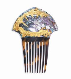 Hair comb by Rene Lalique, ca.1902. Horn, topaz, diamonds, and gold