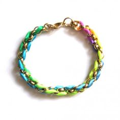 The Neon Kumihimo bracelet is a fashion forward way to add a pop of colour to any look.    Influenced by the art of japanese braiding known as 'Kumihimo', this versatile adornment is handcrafted by weaving cord through belcher chains to create an eye-catching 3D effect. Wear to add edge to daytime separates or layer a few up your arm for serious statement style.