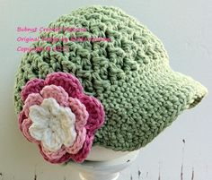 Cute hat,crochet - would do blue with pink flowers for my nieces!