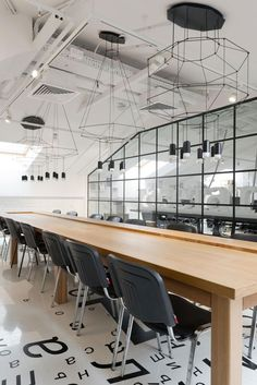 Workspaces of creative companies promote innovative thinking. Firm: Kostow Greenwood Architects. Project: The Shop East at VSP Global. Site: New York. Standout: ...