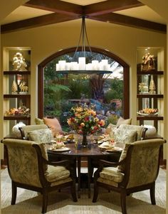 nice built ins and window, ceiling treatment and chandelier is good for the feel of this room- window seat is nice