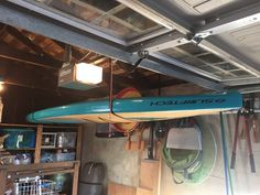 hang your paddleboard from the ceiling of your garage to get organized and save space