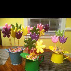 Dollar tree spring decor! these are so easy to do- the buckets, floral foam, Easter grass and flowers are all from there. I broke the flower sticks into different lengths to stagger the flowers.