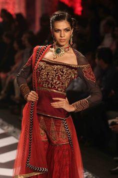 A model walks the ramp of the Indian International Jewellery Week